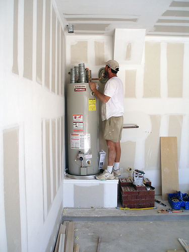 one of our San Leandro plumbers installs A.O. Smith water heater